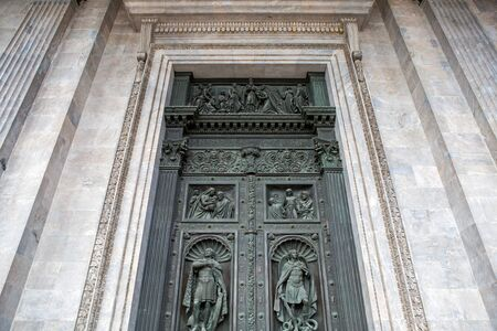isaac s: Saint Petersburg, Russia - 10 July : ancient decorated door St. Isaac Cathedral Built in 1818-1858 years by architect Auguste Montferrand ,the days of military glory of Russia on 10 July, 2016.