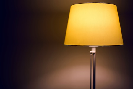 bedside: yellow small bedside lamp in the apartment