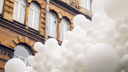 into: lot of white balloons fastened together into one Stock Photo