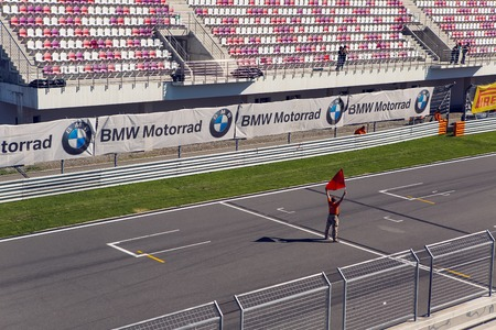 shootings: Moscow region, Russia - 27 August : route Moscow raceway man with a red flag on the Moto track before the race in day of Russian cinema 27 August, 2016. Editorial