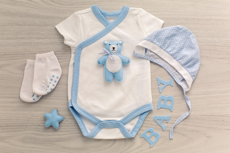 matching: infant bodysuit with matching hat and socks lying on a white table Stock Photo