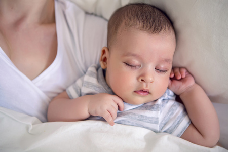 premature: baby sleeps next to mom