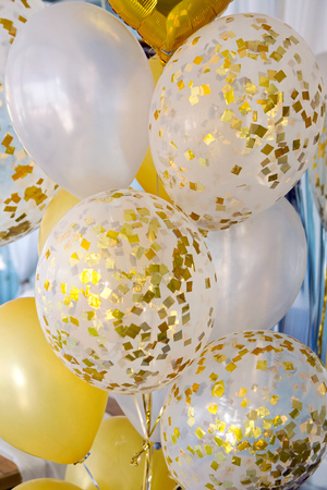 more festive balloons filled with gold glitter confetti