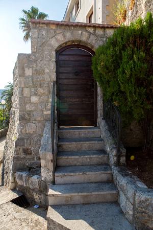 old wooden green doors in Montenegro in Kotor Stock Photo