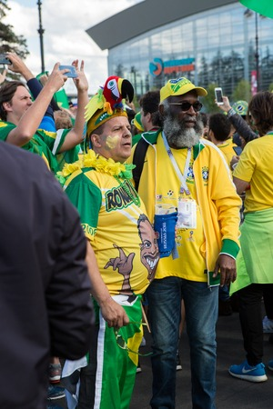 ST. PETERSBURG, RUSSIA - JUNE 22, 2018: Brazilian football fans are happy with the victory over Costa Rica of their team in the square next to the stadium on june 22, 2018 Editorial
