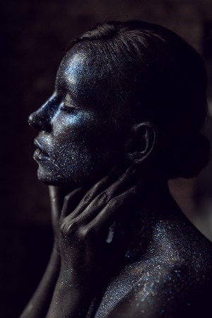 portrait of a black girl painted with paint