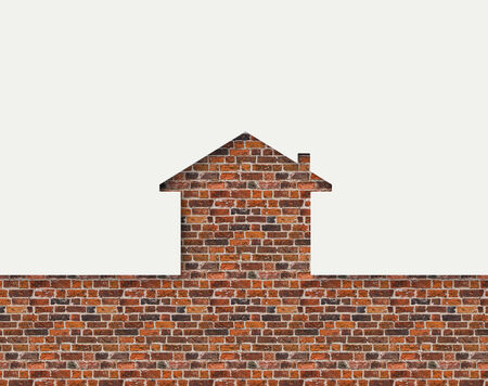 House shaped white wall with bricks behind