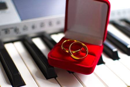 wedding rings on top of piano keys