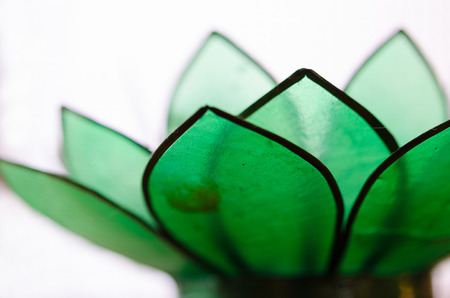 centering: Close up detail shot of green glass open lotus flower