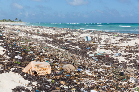 roo: A wide landscape shot of plastics and other garbage washed up by the ocean onto the beach at Punta Allen, Mexico Stock Photo