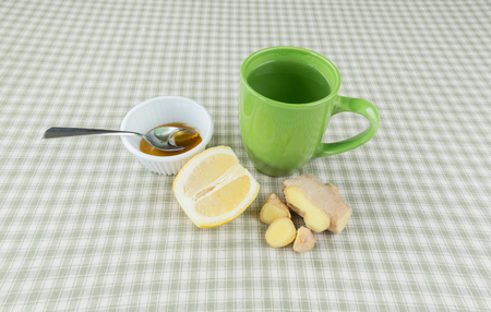 overhead shot: An overhead shot of ingredients to make ginger lemon tea with honey