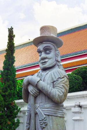 Man stone is decorate Wat Pho, Bangkok, Thailand. photo