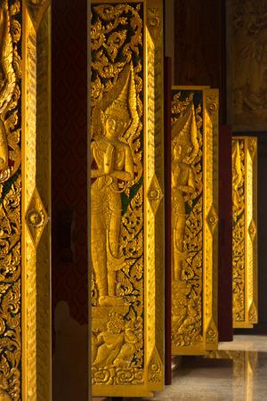 caving: Art door are caving woods style Thai art of Thai church, Thailand.