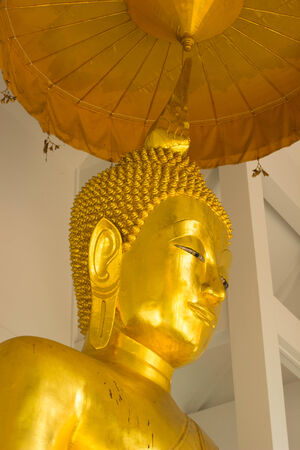 Buddha of Wat Gold Mountain are while ancientremains of Thailand. photo