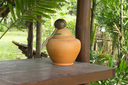 house ware: Jar make forn clay use to water and keep something food for old Thai house.