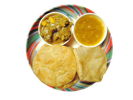 non vegetarian: Puri or Indian bread served with dal and lamb curry