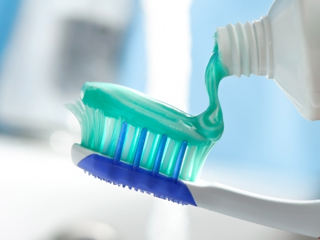 tooth brush: Squeezing toothpaste on toothbrush
