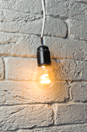 Old lit electric bulb  photo