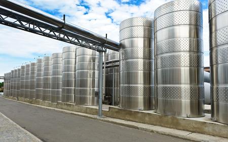 liquid state: Modern aluminum barrels where grape juice is aged into wine Stock Photo