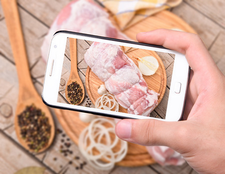 meatloaf: Hands taking photo meatloaf with smartphone Stock Photo