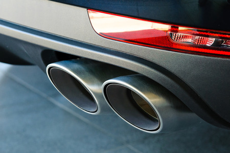 exhaust pipe: Close up of a car dual exhaust pipe