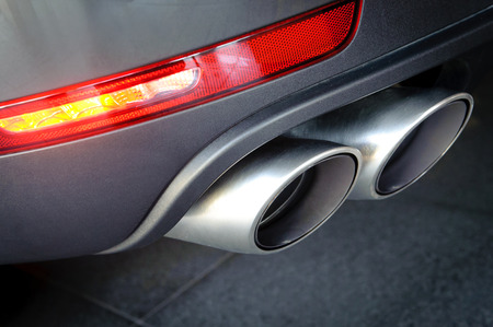 Close up of a car dual exhaust pipe Фото со стока - 40252036