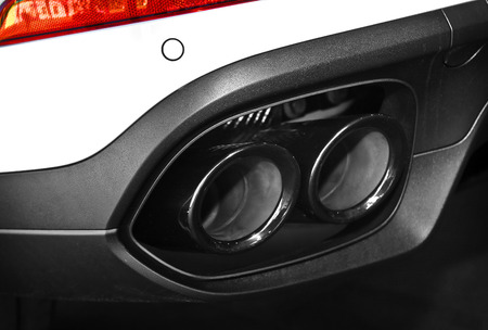 dual: Close up of a car dual exhaust pipe