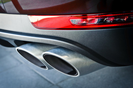 Close up of a car dual exhaust pipe photo