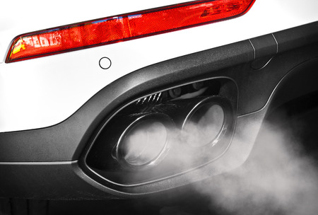 vehicle part: Close up of a car dual exhaust pipe