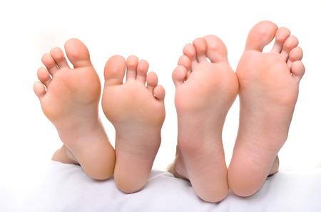 female soles: Female legs and male legs. Stock Photo