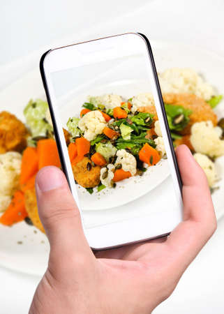 flavorsome: Hands taking photo salad with smartphone Stock Photo