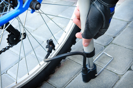 inflating: Inflating the tire of a bicycle. Stock Photo