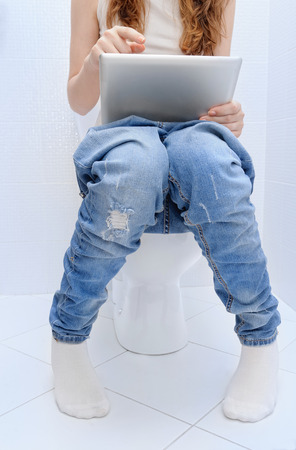 smart girl: Woman with a tablet pc in a toilet