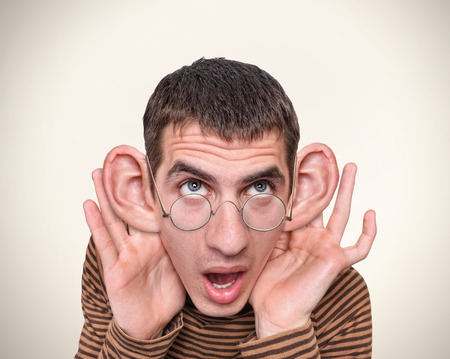 Man listening with big ears