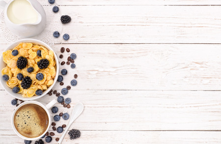 Breakfast with coffee, corn flakes, milk and berry. Reklamní fotografie
