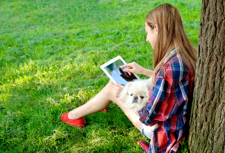 Girl using a digital tablet outdoors