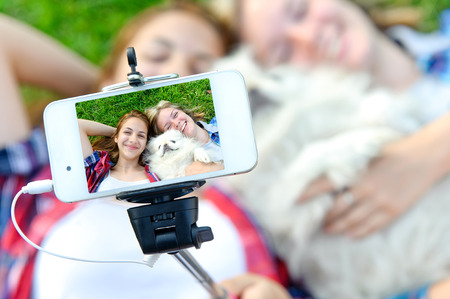nature picture: Beautiful girls with dog taken pictures of her self, instagram Stock Photo