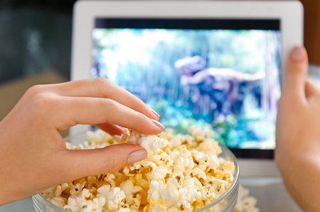 popcorn bowls: Watching a movie on digital tablet