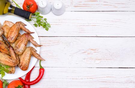 pollos asados: Alitas de pollo. Fondo.
