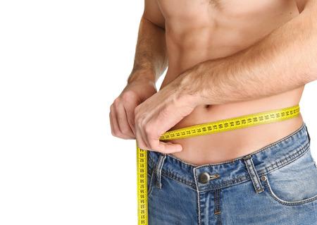 man measurement: Young man measuring her waist