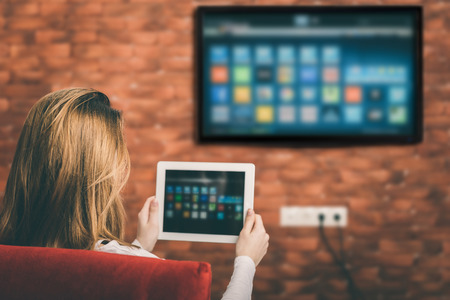 Closeup of a tablet is connected to a smart TV. Standard-Bild