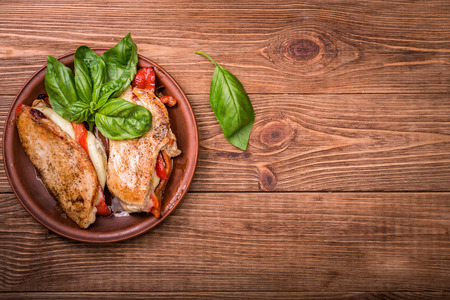 Roasted red pepper, mozzarella and basil stuffed chicken. Stock Photo