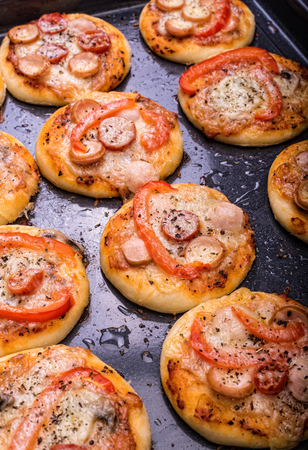 mini pizza: Mini pizza. Concept of cooking. Stock Photo