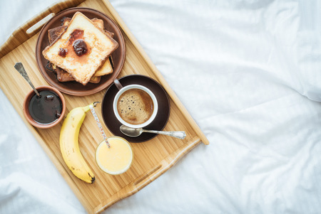 Breakfast in bed - french toasts with a cup of coffee. Stock Photo