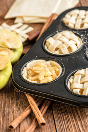 mini oven: Fresh homemade delicious apple muffins. Concept of cooking. Stock Photo