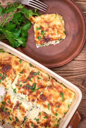 Chicken lasagna and white cheese.