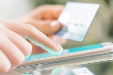 Woman is shopping online using a smartphone.