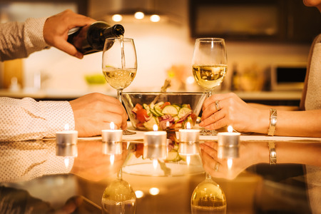 Wine is poured into a glass. Romantic concept.