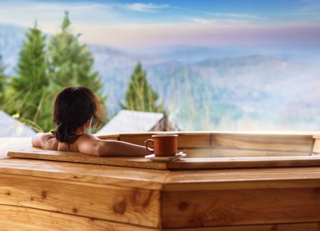 Woman in an open air bath Stock Photo
