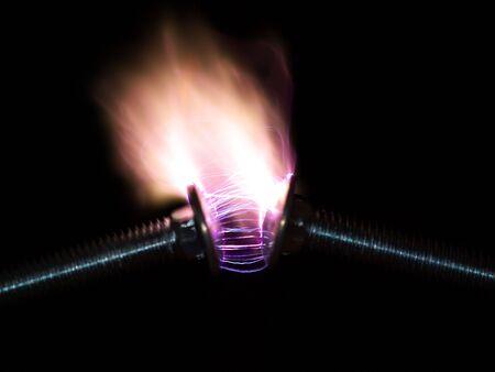 volts: 15,000 volts arcingdischarging  across two steel bolt heads